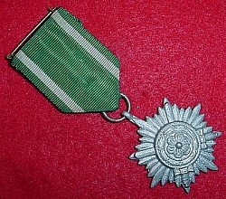 "Nazi ""Ostvolk"" Eastern People's Medal 2nd Class with Swords and Marked Ring...$70 SOLD"